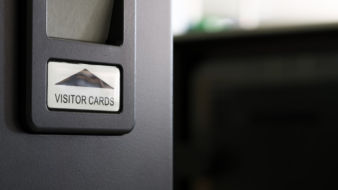 Visitor card return slot
