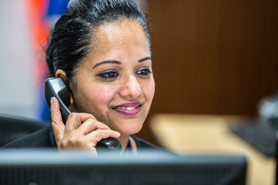Fastlane turnstiles Product Support worker on telephone to client