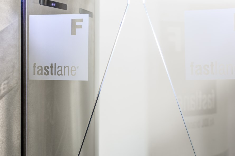 Fastlane logo displayed on entrance control security turnstile glass wing