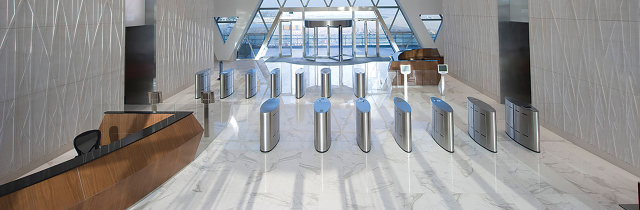 Fastlane Glasswing speedgates entrance control security turnstiles in situ in lobby