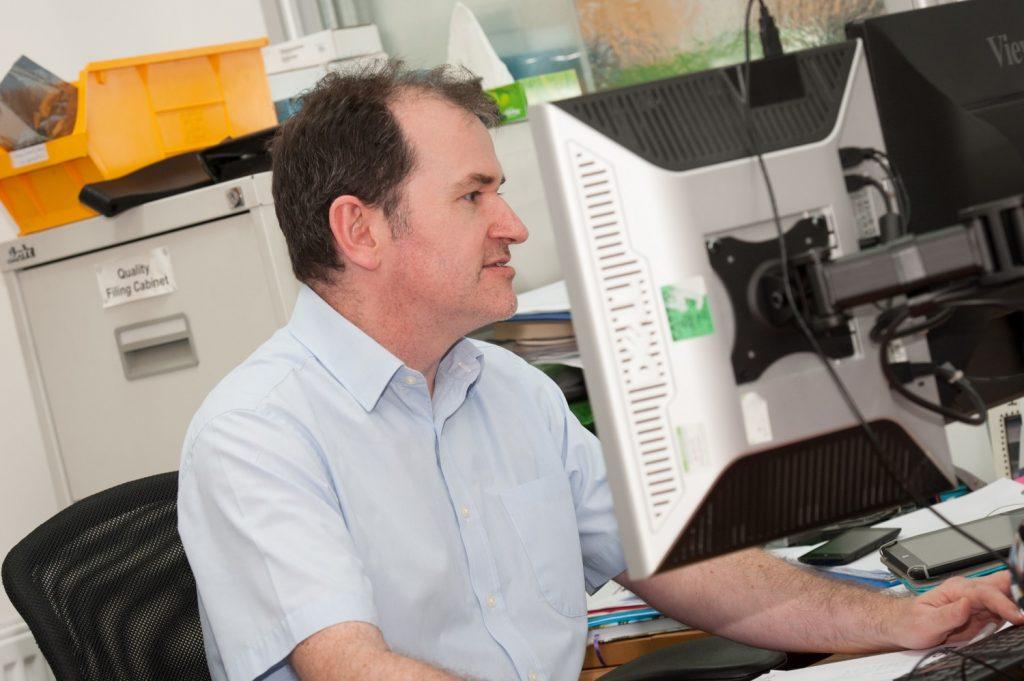 Stephen Keeping Fastlane HSEQ Manager sitting at desk