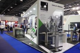 Fastlane Turnstiles exhibition stand with personnel
