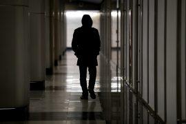 suspicious man in hallway