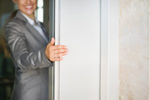 woman holding door open collusion