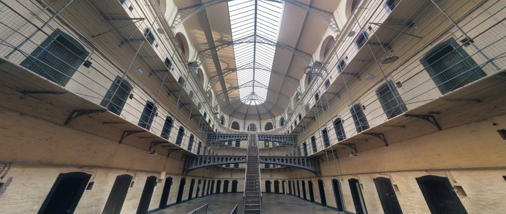 inside of a prison showing cells