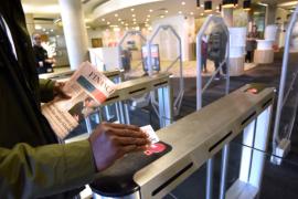 Man swiping card Teeside Library
