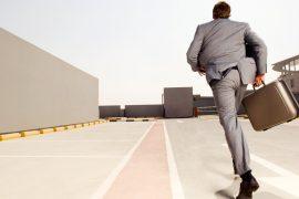 man running across car park